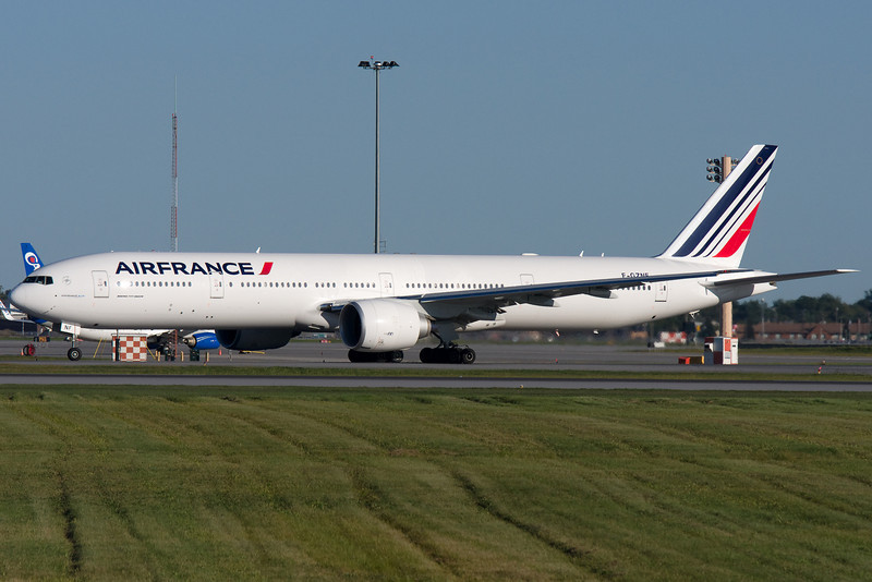 Air France's 777-300ER with new colors taxiing for departure at Montreal.