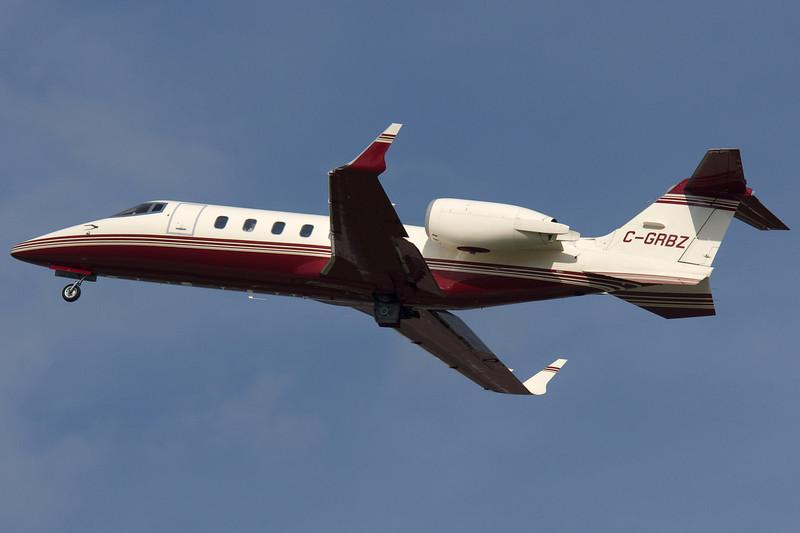 Learjet 45 taking off from 24L.