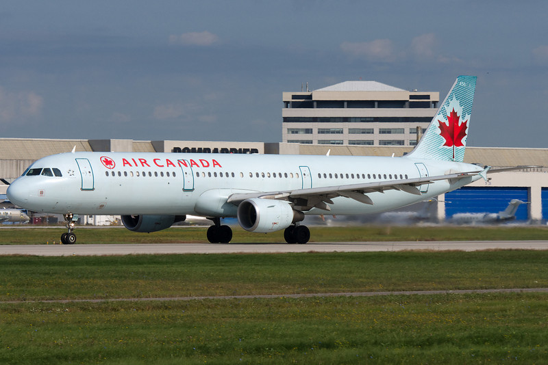 An Air Canada Airbus A321 lifting up from runway 24L.