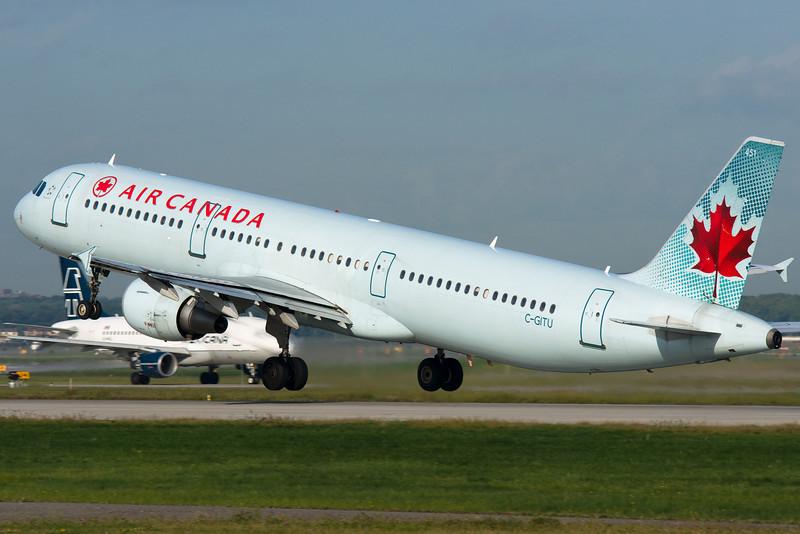 Air Canada Airbus A321 lifting up from runway 24L at Montreal.