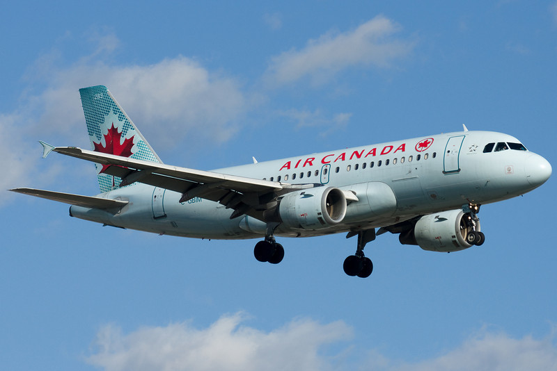 Lots of these guys too, Air Canada's A319 on final for 24R.