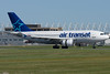 An Air Transat A310 arrives at Montreal.