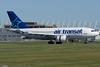 An Air Transat A310 arrives at Montreal.