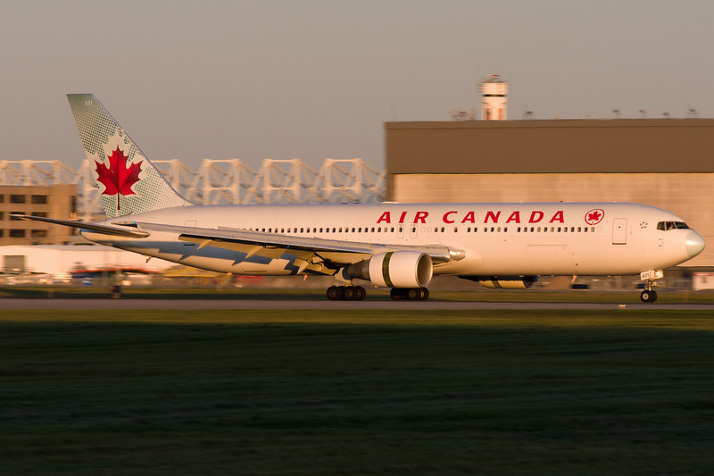 Air Canada 767 slowing down 24R after landing at sunset.
