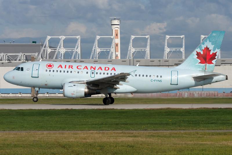 Air Canada Airbus A319 rotating from runway 24L at Montreal.