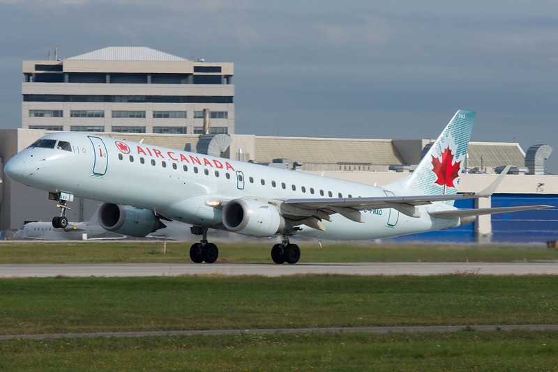 Embraer E190 lifting up from runway 24L  at Montreal.