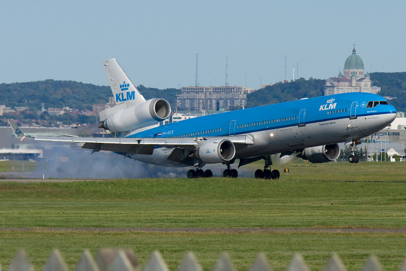 KLM MD-11 Ingrid Bergmann arriving at Montreal. Yes, that is a crow by the slat.