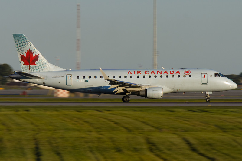 Air Canada Embraer taking off from runway 24R at Montreal.