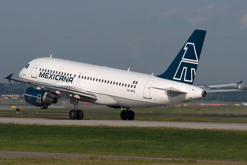Mexicana A320 rotating from runway 24L at Montreal.