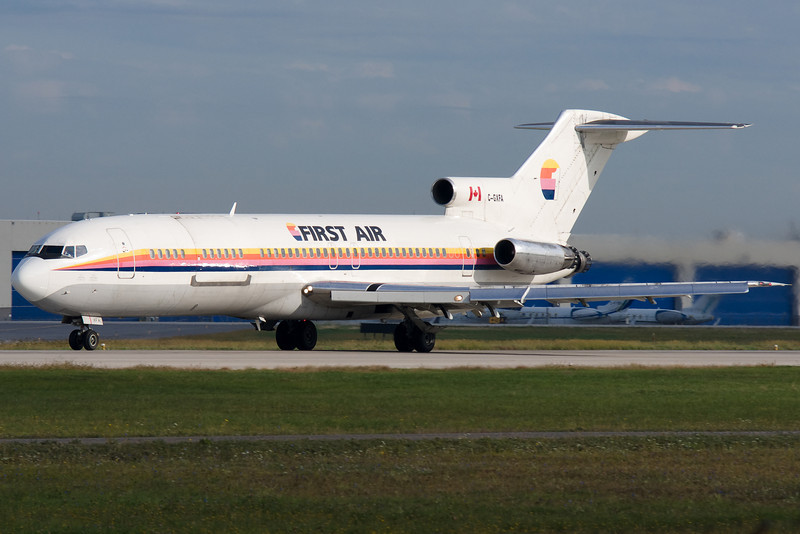 Rolling down runway 24L at Montreal for this First Air 727.