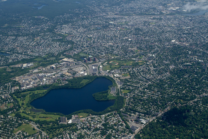 Fresh Pond (public water supply reservoir for Cambridge).  Alewife MBTA station visible just beyond it.
