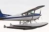 Cessna A185F Skywagon C-GEUU taking off on the Moose River at Moosonee, Ontario.