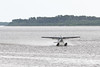 Cessna A185F Skywagon C-GEUU taking off on the Moose River at Moosonee, Ontario.