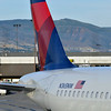 KSLC - N365NW-A320-212   Got a bit of glare from the terminal window on this one, but shows the tail of N365NW, terminal across the ramp and the mountains in the background.