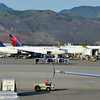 KSLC - Looking across the ramp at N355NW (A320-212) and the mountains.