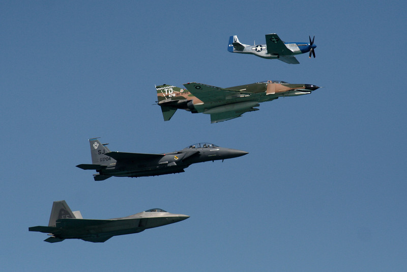 Heritage Flight.  F-22 Raptor, F-15 Eagle, F-4 Phantom, P-51 Mustang.
