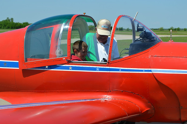 Pilot Don Rogers helps an excited Jonah Buss strap in before his flight over Southwestern Oklahoma.