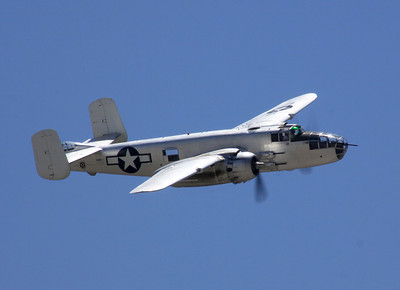 "The B-25J ""Photo Fanny"" flies past the crowd at the 2014 Planes of Fame airshow in Chino, CA."