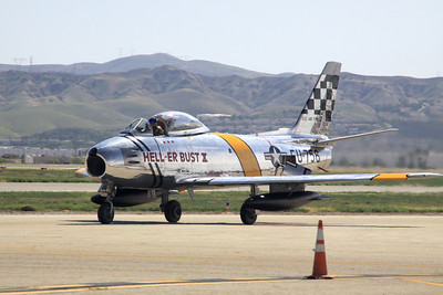 "The F-86 ""HELL-ER BUST X"" taxies along the tarmac at the 2014 Planes of Fame airshow in Chino, CA."