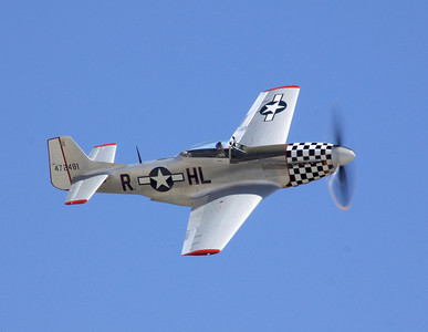 "The P-51D ""Baby Doll"" flies past the crowd at the 2014 Planes of Fame airshow in Chino, CA."