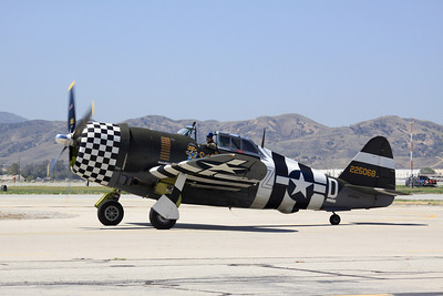 A razor back P-47D taxies past the crowd at the 2014 Planes of Fame airshow in Chino, CA.