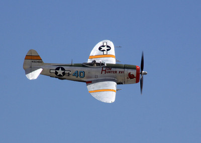 "The bubble-top P-47D ""Hun Hunter XVI"" flies past the crowd at the 2014 Planes of Fame airshow in Chino, CA."