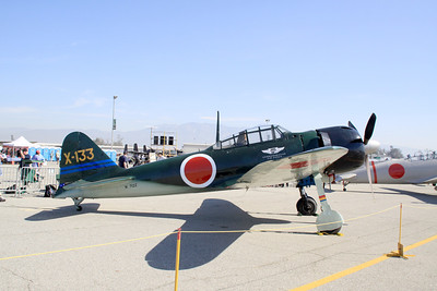 The Commemorative Air Force A6M Zero fighter on display at the 2014 Planes of Fame airshow in Chino, CA.