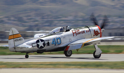 "The P-47D ""Hun Hunter XVI"" rolls out after landing during the 2014 Planes of Fame airshow in Chino, CA."