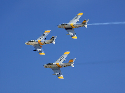 The Horsemen F-86 flight demonstration team banks over the crowd at the 2014 Planes of Fame airshow in Chino, CA.