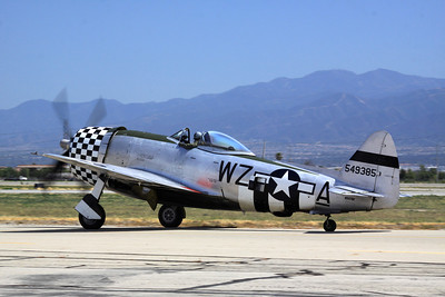 A bubble-top P-47D taxies past the crowd at the 2014 Planes of Fame airshow in Chino, CA.