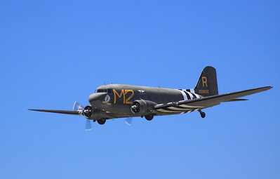 "The C-54 ""D-Day Doll"" flies past the crowd during the 2014 Planes of Fame airshow in Chino, CA."