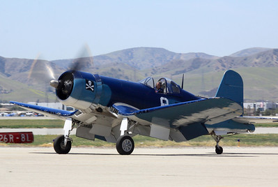 An F4U-1 Corsair fighter taxies along the ramp at the2014  Planes of Fame airshow in Chino, CA.