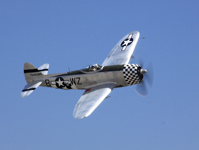 A bubble-top P-47D flies past the crowd at the 2014 Planes of Fame airshow in Chino, CA.
