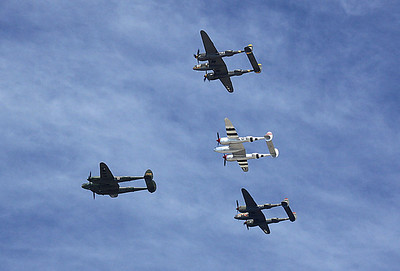 A rare group of four P-38s flies over the crowd.