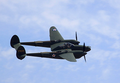 "The ""Glacier Girl"" P-38E Lightning flies past the crowd."