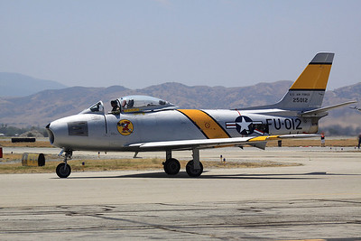 North American F-86 Saber jets taxis past the crowd.