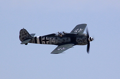 Focke-Wulf FW190-A8 fighter flying past the crowd.