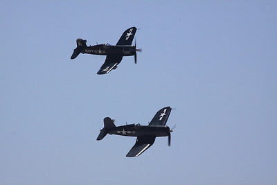 A pair of F-4U Corsairs flying in formation.
