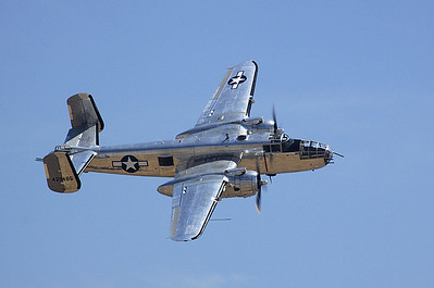 """Guardian of Freedom"" B-25J Mitchell bomber banks past the crowd."