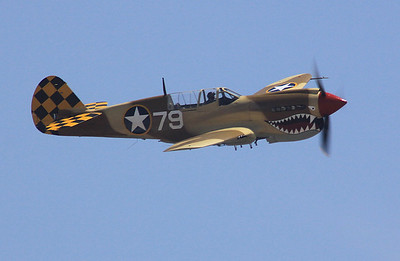A Curtis-Wright P-40N Tomahawk making a flyby.