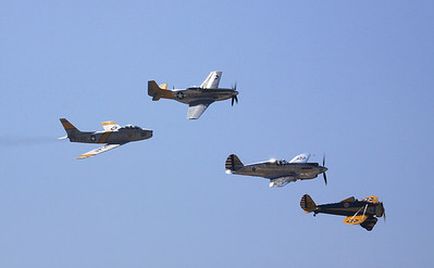 A heritage flight of four generations of US fighters - P26 Peashooter, P-40A Tomahawk, P-51D Mustang and F-86 Saber - opened the flight demonstrations.