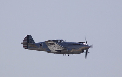 A rare Curtis-Wright P-40A Warhawk in flight.
