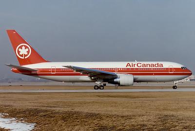 Air Canada Boeing 767-233/ER Toronto - Lester B. Pearson International (Malton) (YYZ / CYYZ) Canada - Ontario, March 1989 Reg: C-GDSS Code: 614 Cn: 24143/233 Early morning departure ready to take RWY 24R.