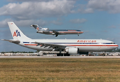 American Airlines Airbus A300B4-605R  Miami - Intl.  (MIA / KMIA) USA - Florida, November 1996 Reg: N14077  Cn: 612 Grey fuselage colours on this classic A300.