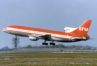 LTU - Lufttransport-Unternehmen Lockheed L-1011-385-1 TriStar 1  Munich - Riem (MUC / EDDM) (closed) Germany, February 15, 1981  D-AERU (cn 193L-1125) Shortly before touching down on RWY 25, in the background the famous hill for planewatchers at Riem is visible.