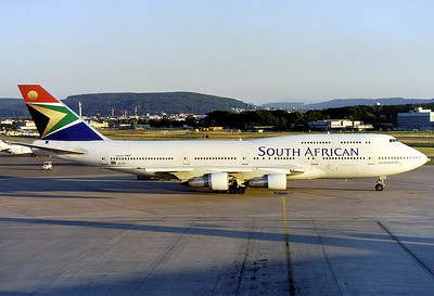 South African Airways Boeing 747-344 	Zurich (- Kloten) (ZRH / LSZH) Switzerland, June 2001 Reg: ZS-SAT  Cn: 22970/577 Late summer evening scene, 'Johannesburg' is on its way back to South Africa.