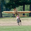 Race of the Century: Kelsey Bjornson from Carlisle urges her horse, Comet, to victory in a race against Collings Foundation's 1909 Bleriot XI.  The Bleriot is one of the oldest aircraft still flying in the US.