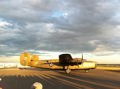 B-24 Liberator at dusk, about to start engines.