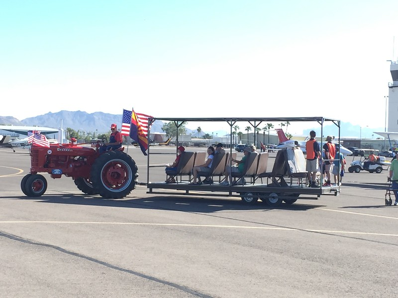 Nice restored Farmall tractor pulling the shuttle around the grounds.