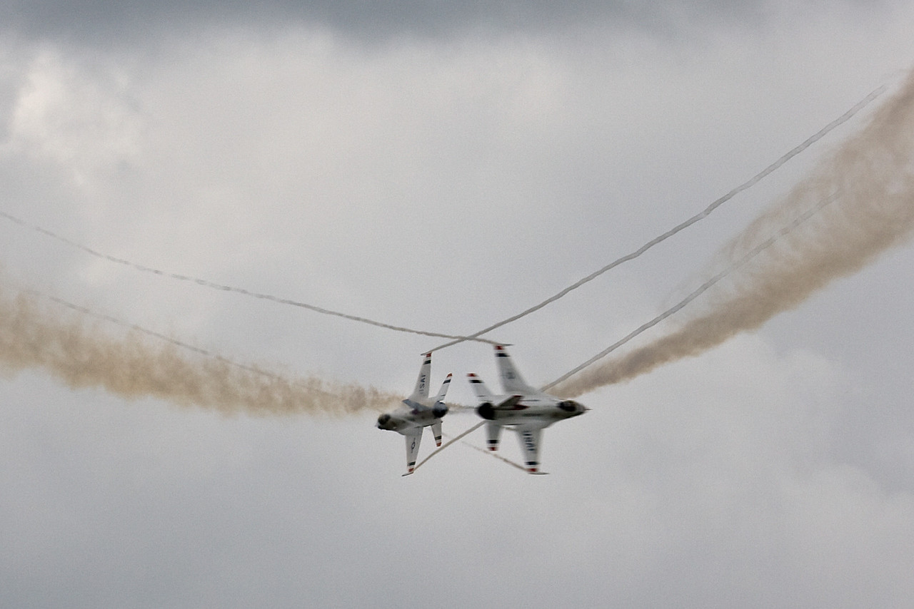 Thunderbirds cross paths after overflying the audience.